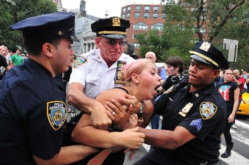 Three Police Officers beat an innocent Girl at an occupy Wall Street Protest in NYC